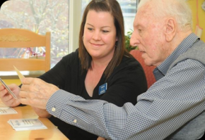 "An Extendicare staff member works through ""My Wishes"" with a Resident."