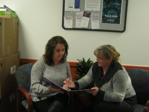 Tina Brash (right) discusses a care plan with Laurie Thompson