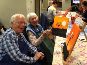 Residents Gordon and Bea having fun at Paint Night